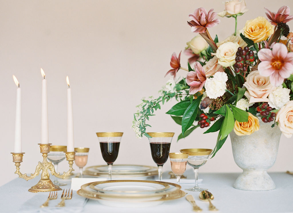 Gold table ware and white table linen for elegant wedding and event tablescape