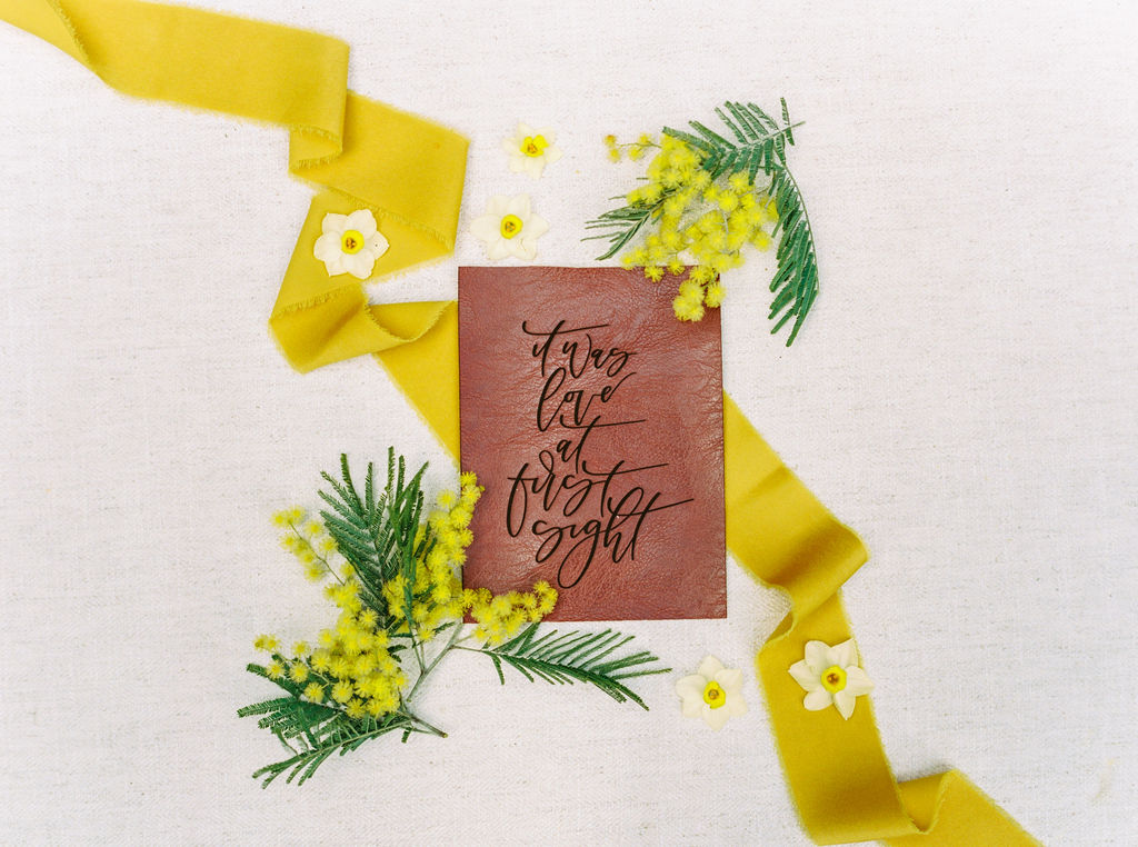 wedding vows calligraphy flatlay with silk ribbons
