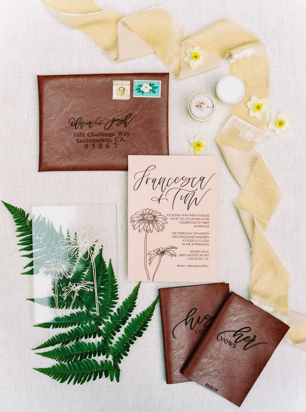 leather and calligraphy wedding invitation suite flatlay with silk velvet ribbons