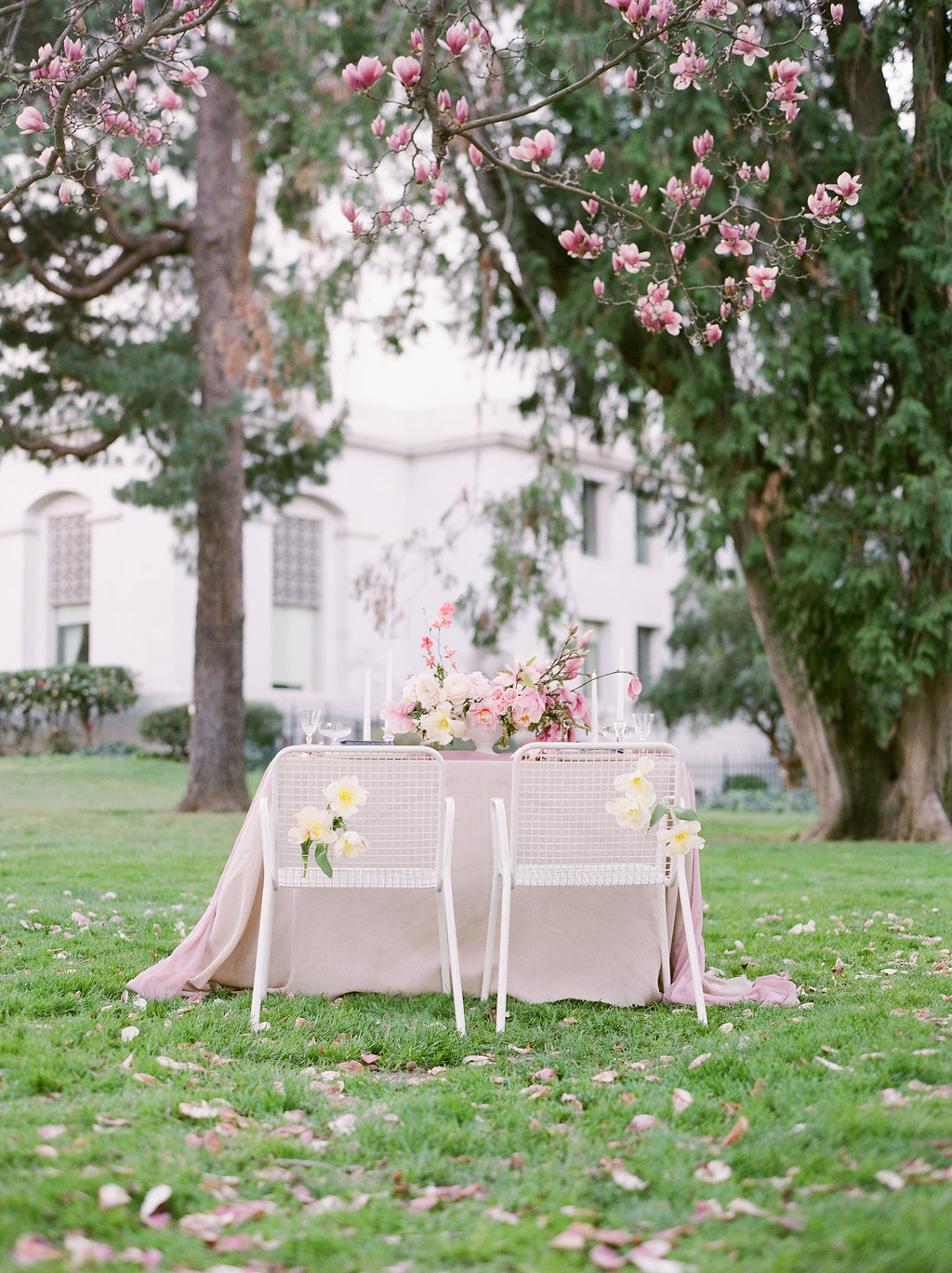 Pink silk velvet table linen and romantic flowers for pretty outdoor wedding tablescape