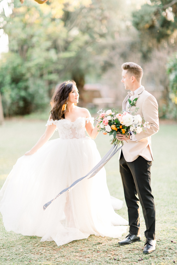 gorgeous wedding gown and groom style idea with long and flowy silk velvet ribbon bouquet for wedding photo shoot