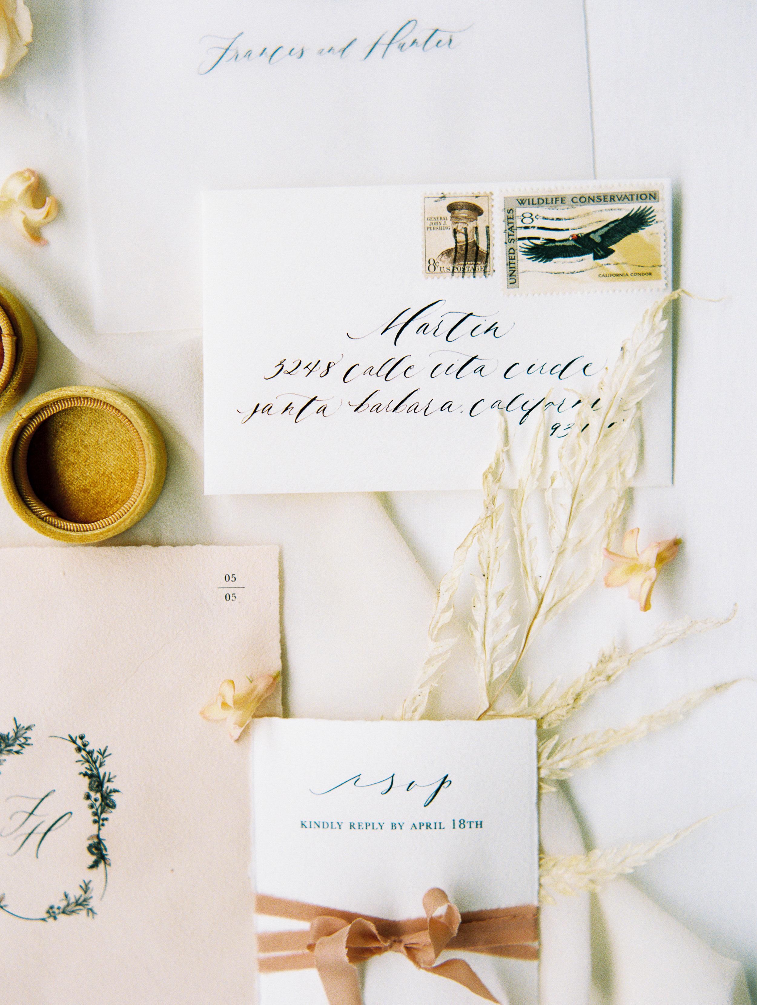 Wedding invitation envelope calligraphy presentation with pretty silk ribbon