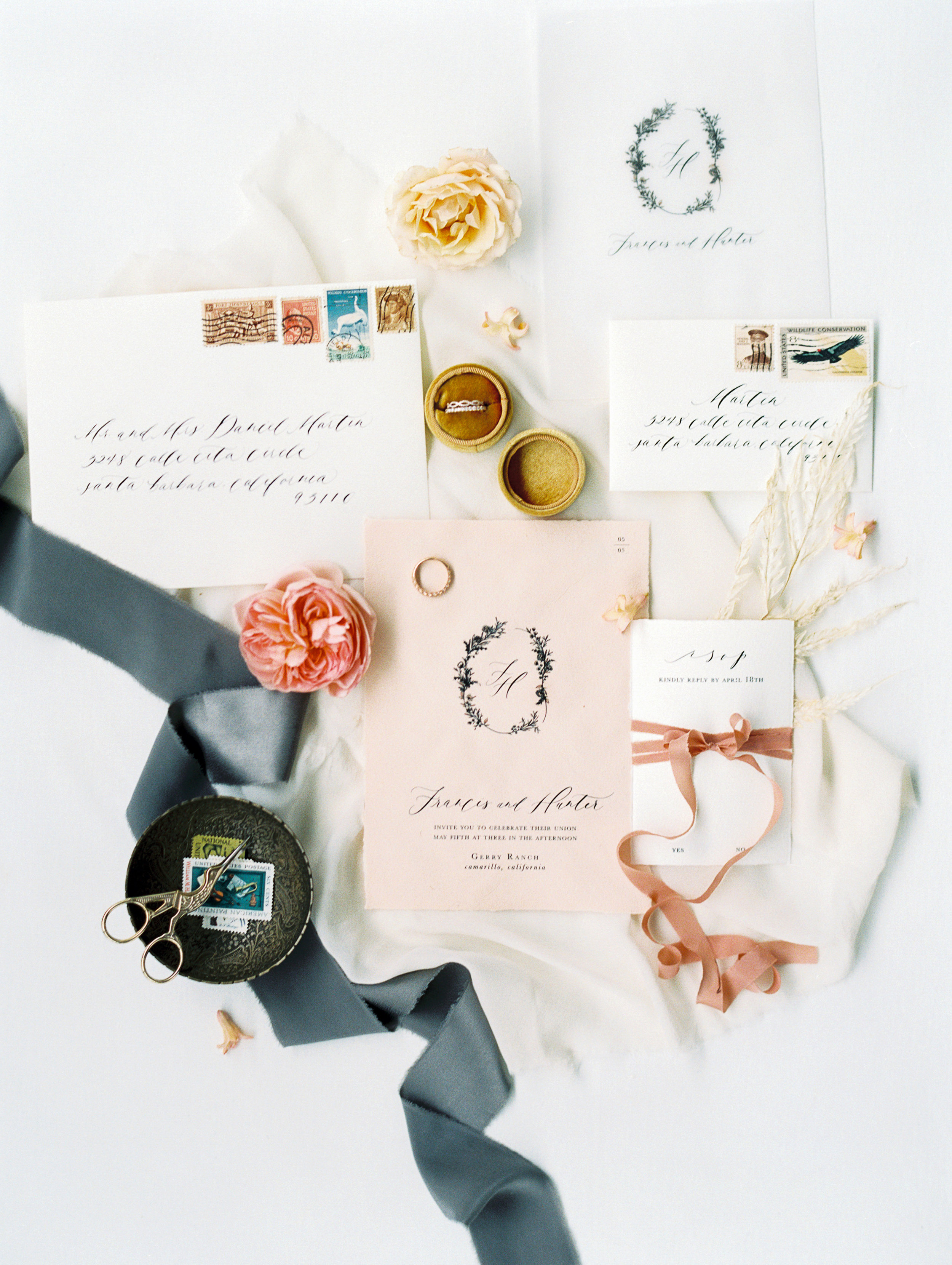 Flowy silk ribbons and linens for romantic wedding invitation calligraphy flatlay idea