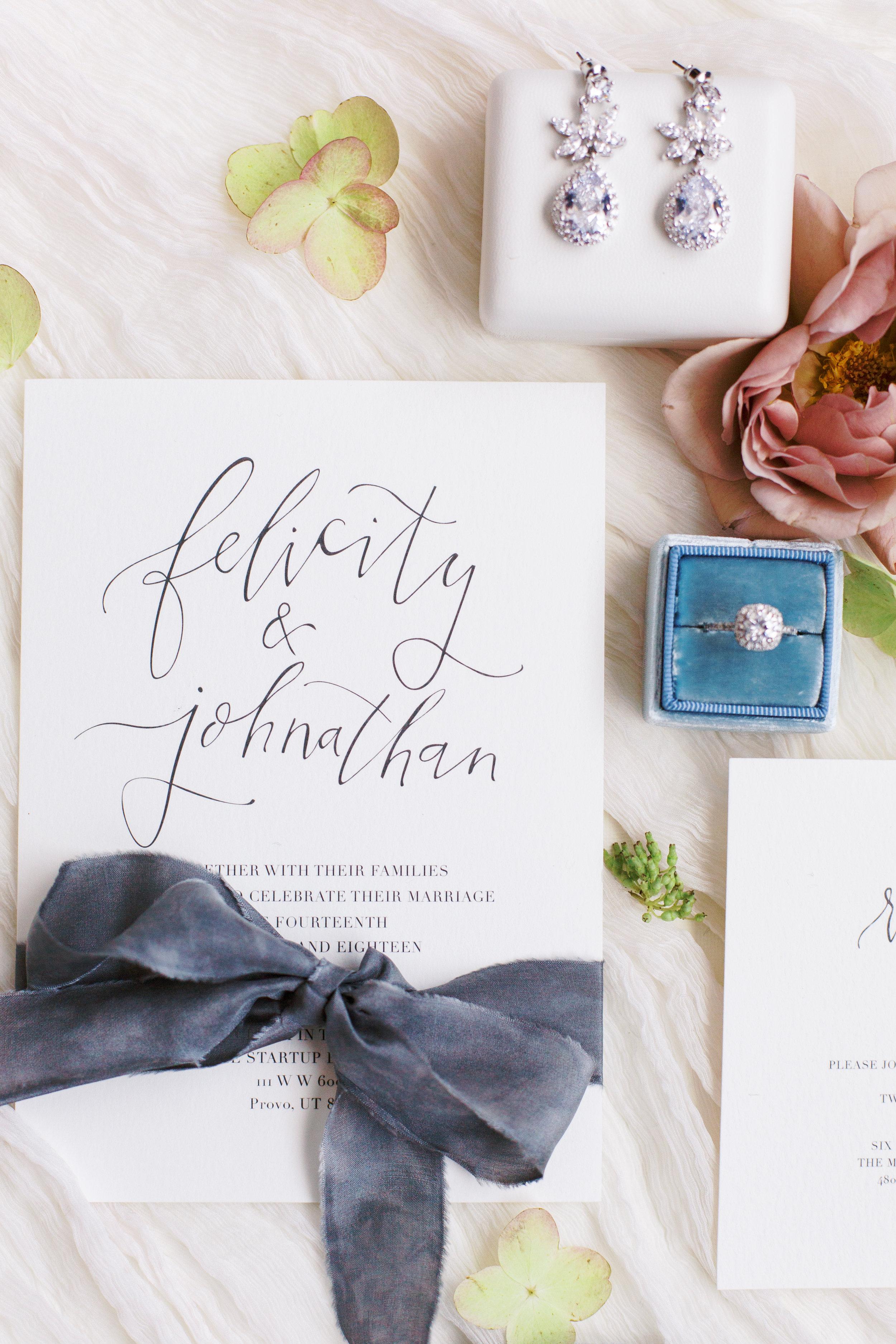 pretty and artsy wedding invitation calligraphy flatlay