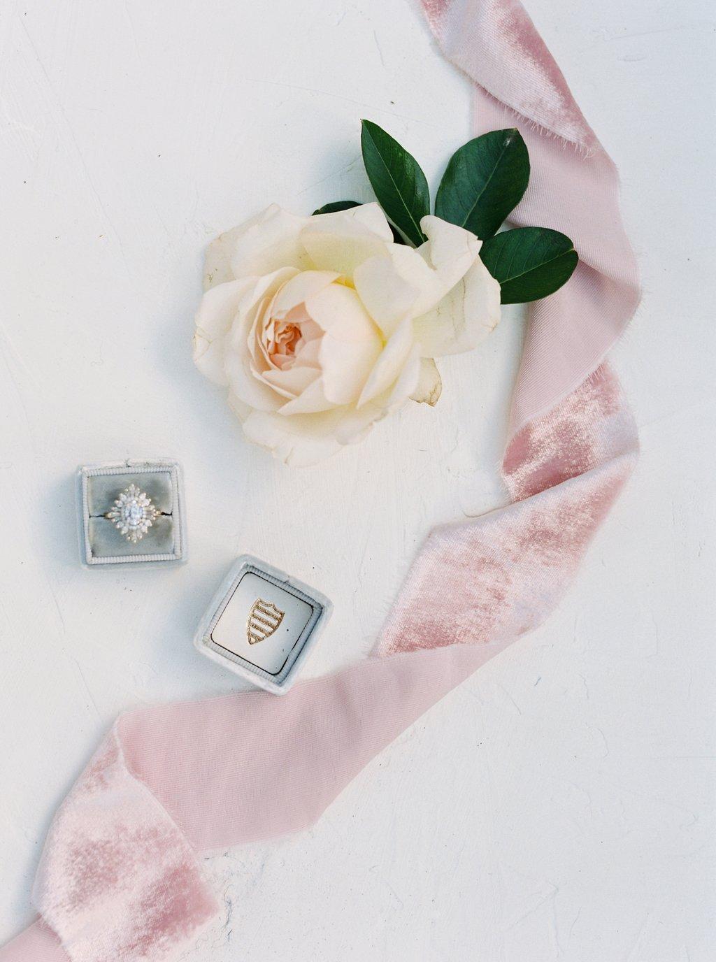 pretty diamond wedding ring flatlay with gorgeous pink silk velvet ribbon