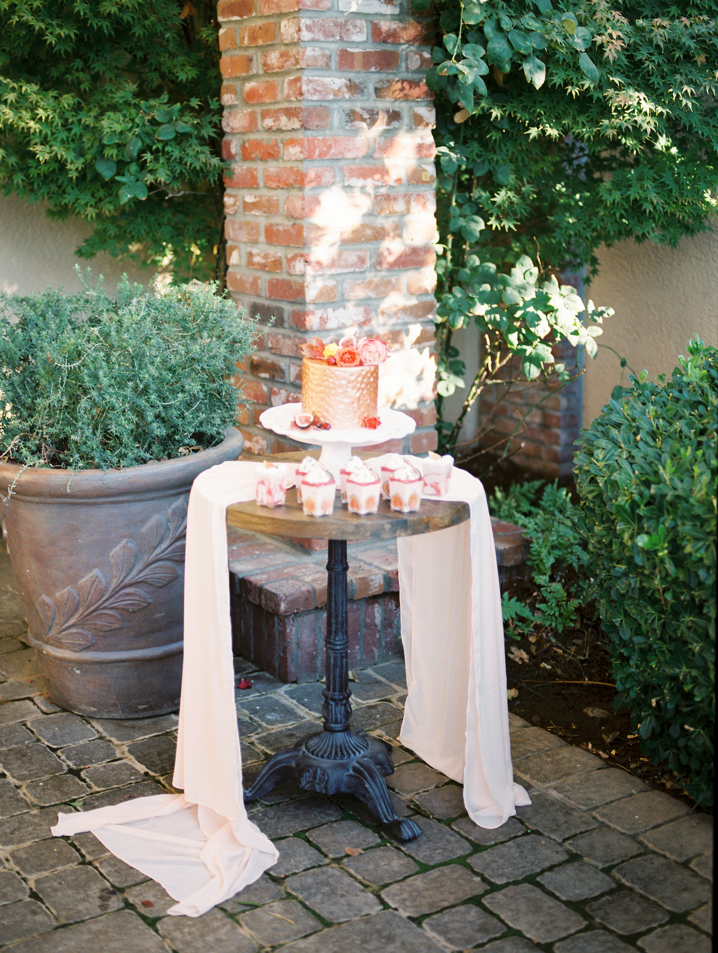 Outdoor Wedding Cake and dessert Table for Fall with Gorgeous and Long Silk Table Runners