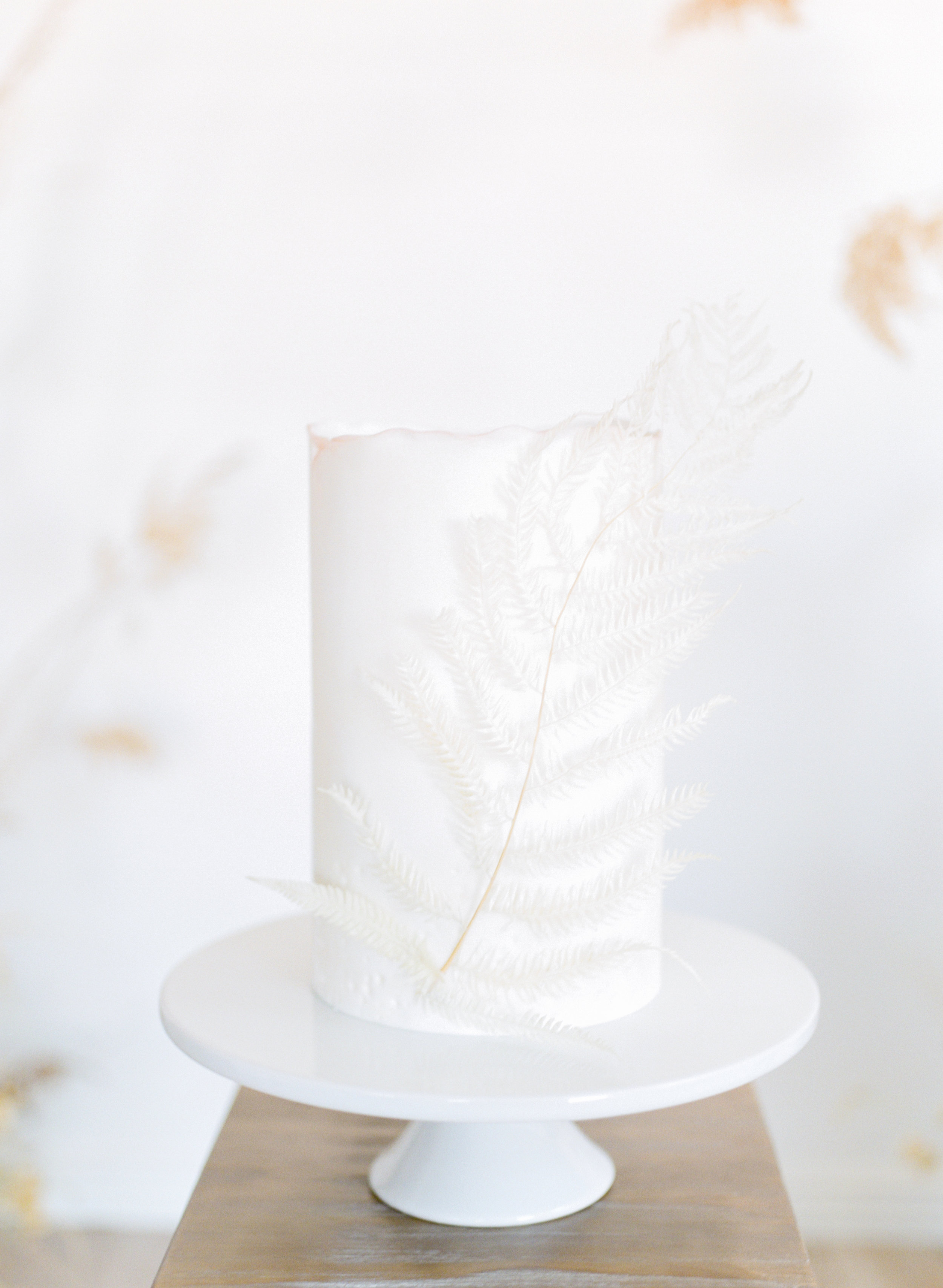 minimalist wedding cake table inspiration with silk table runners