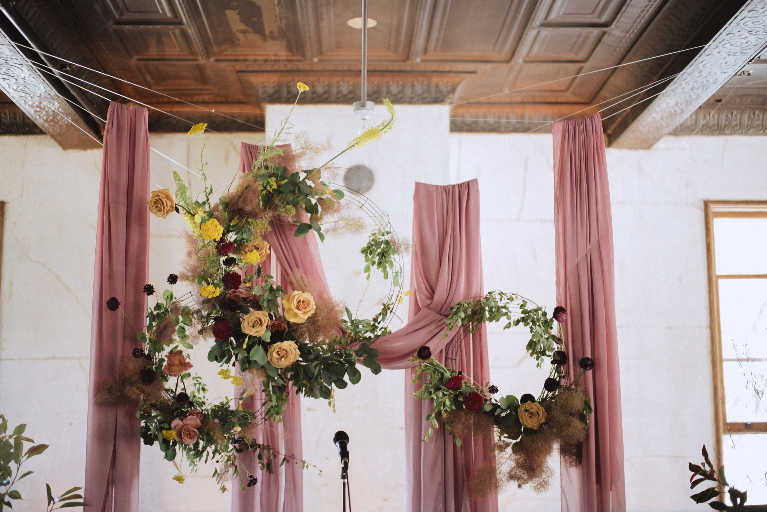 pretty wedding reception design using florals and silk table linens