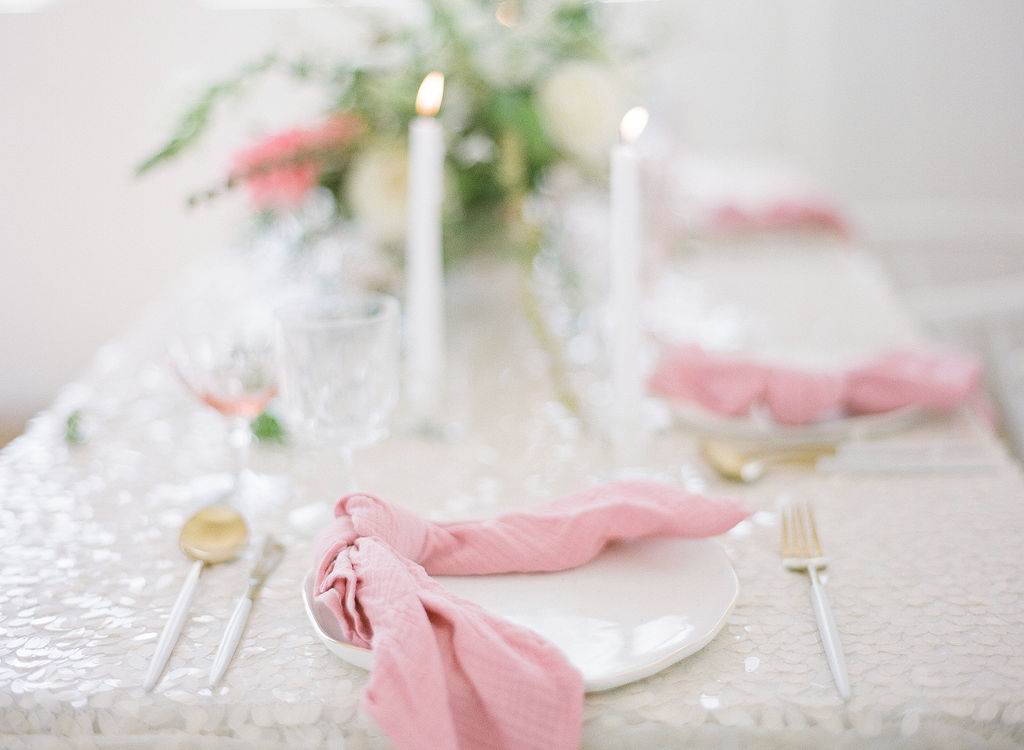 feminine and modern wedding tablescape idea with pink table napkins and sequin linens