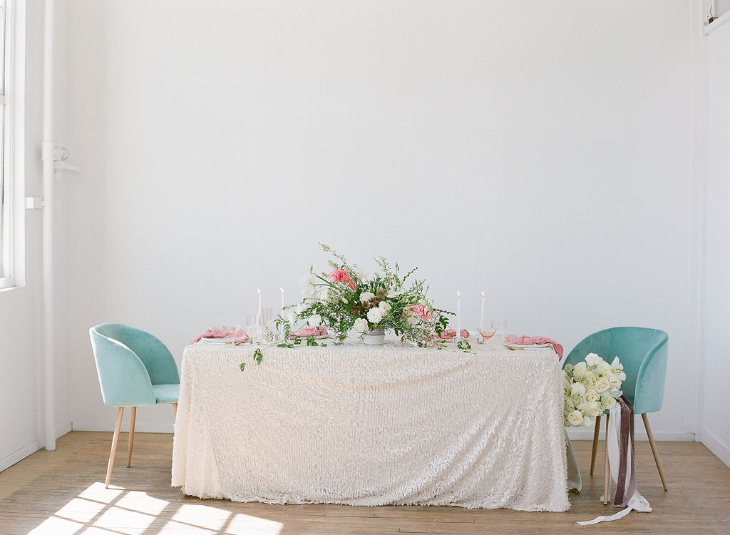 indoor wedding reception tablescape idea with unique sequin table runners