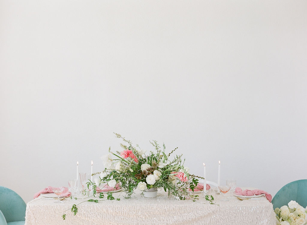 feminine and romantic wedding floral centerpiece on gorgeous tablescape using sequin linens