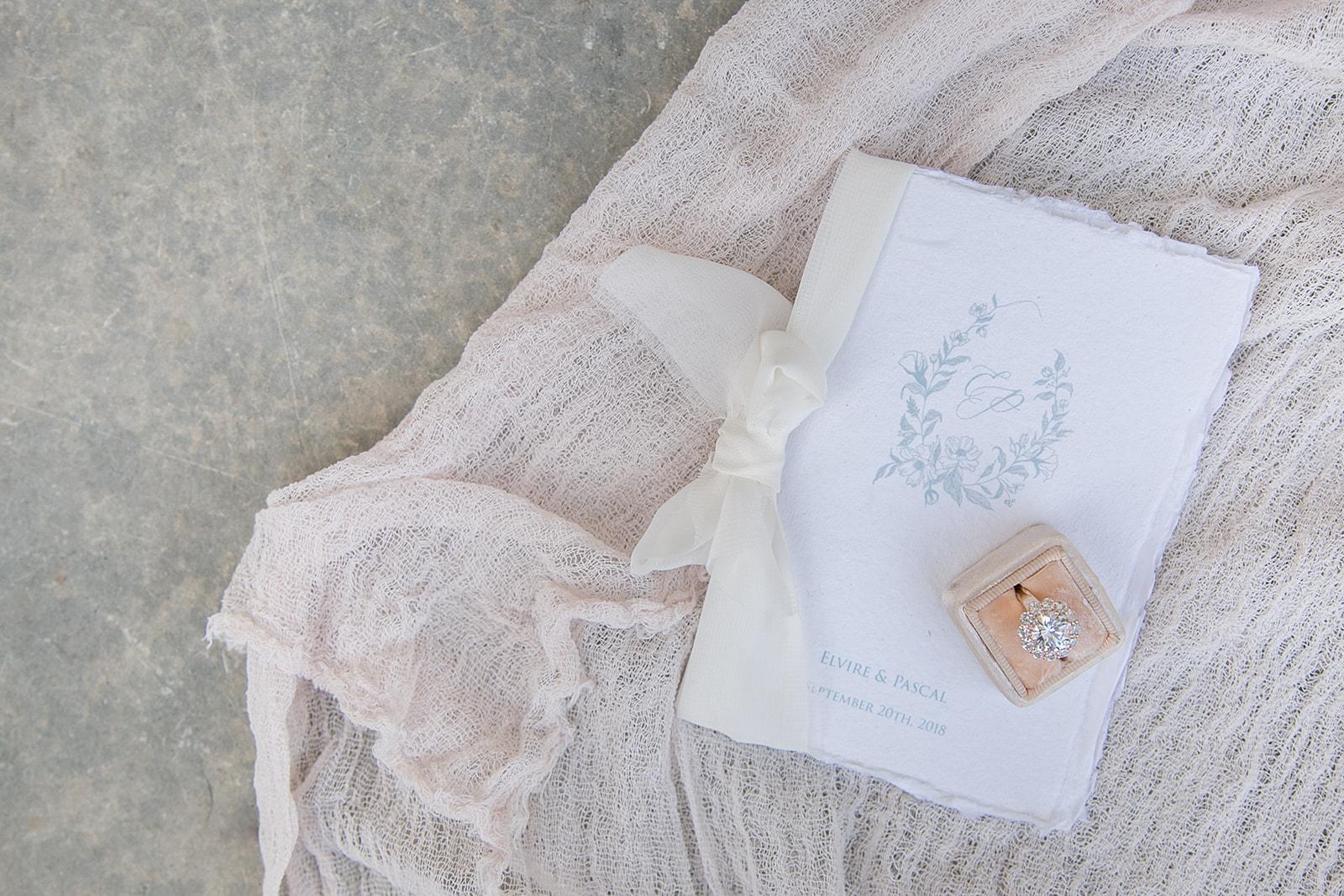 pretty wedding ring and invitation flatlay ideas using gauze table runners