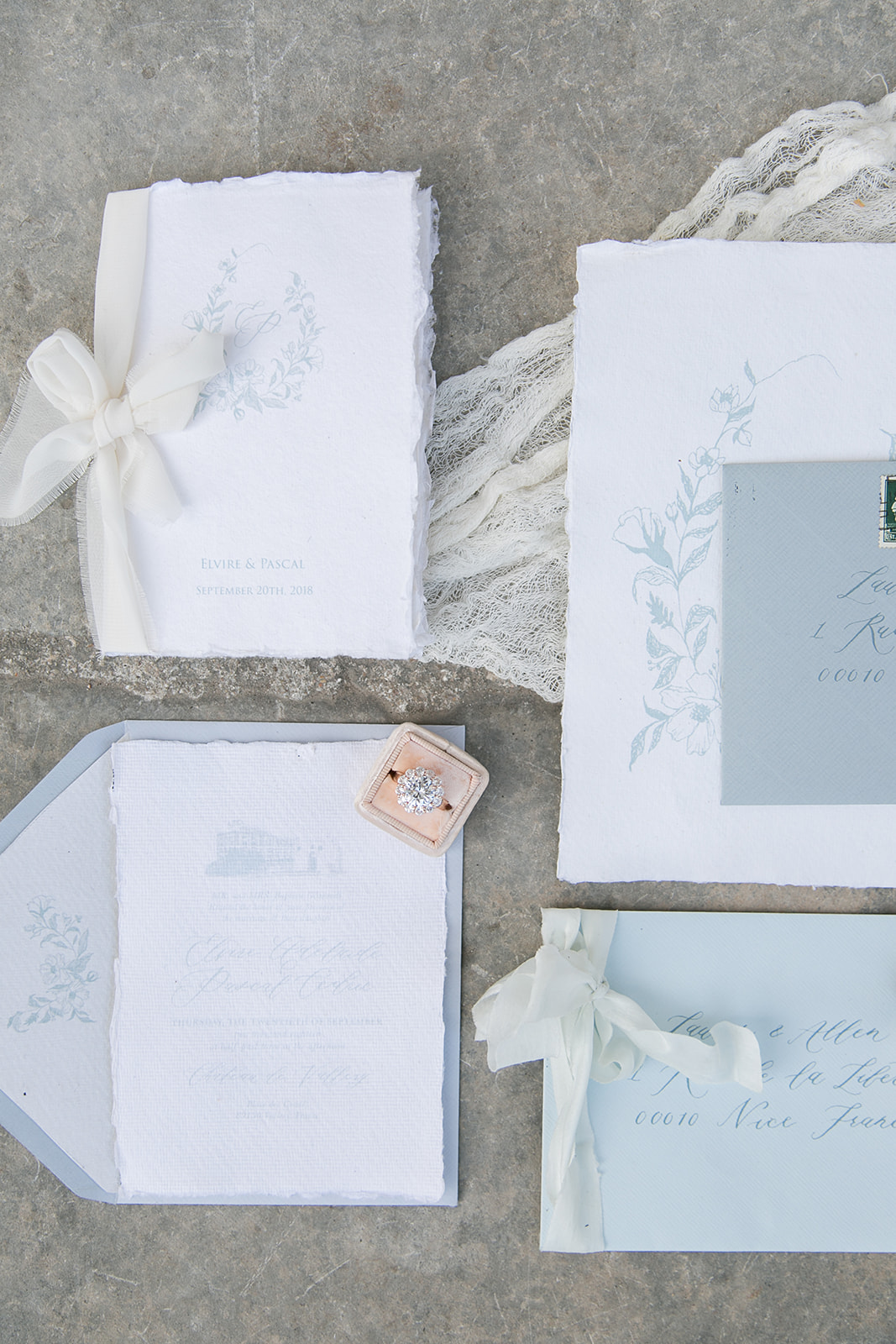 french inspired wedding invitation calligraphy idea with silk ribbons and gauze table runner