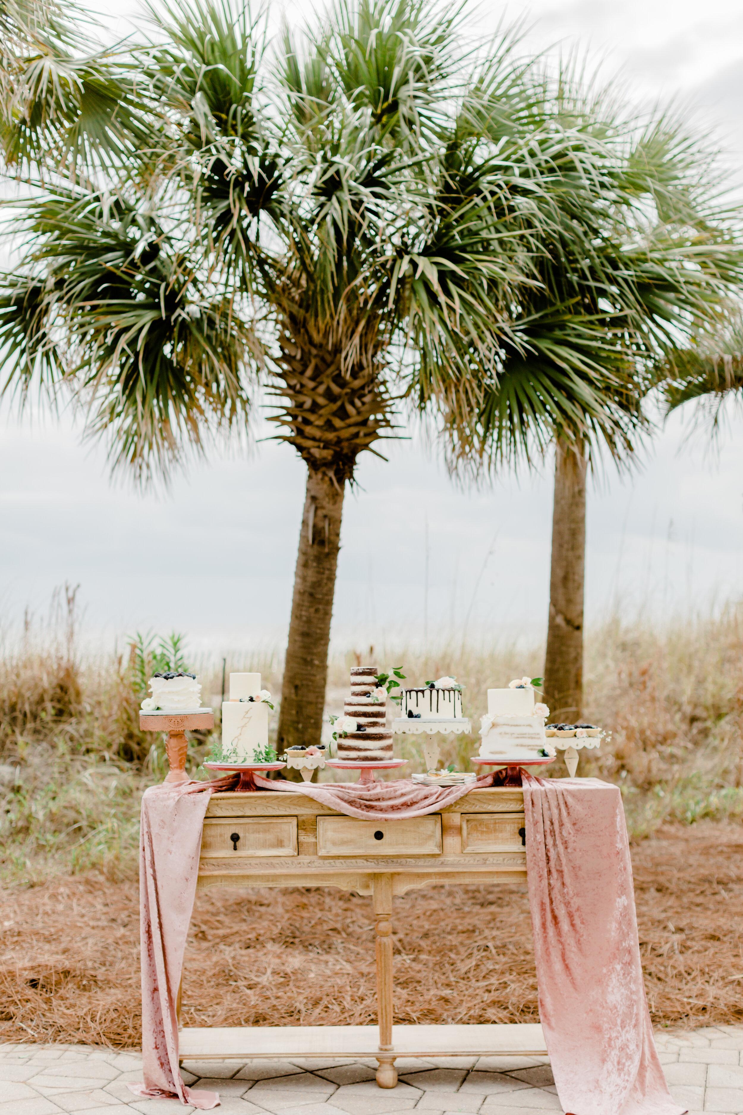 pretty outdoor wedding cake table using silk velvet table runners