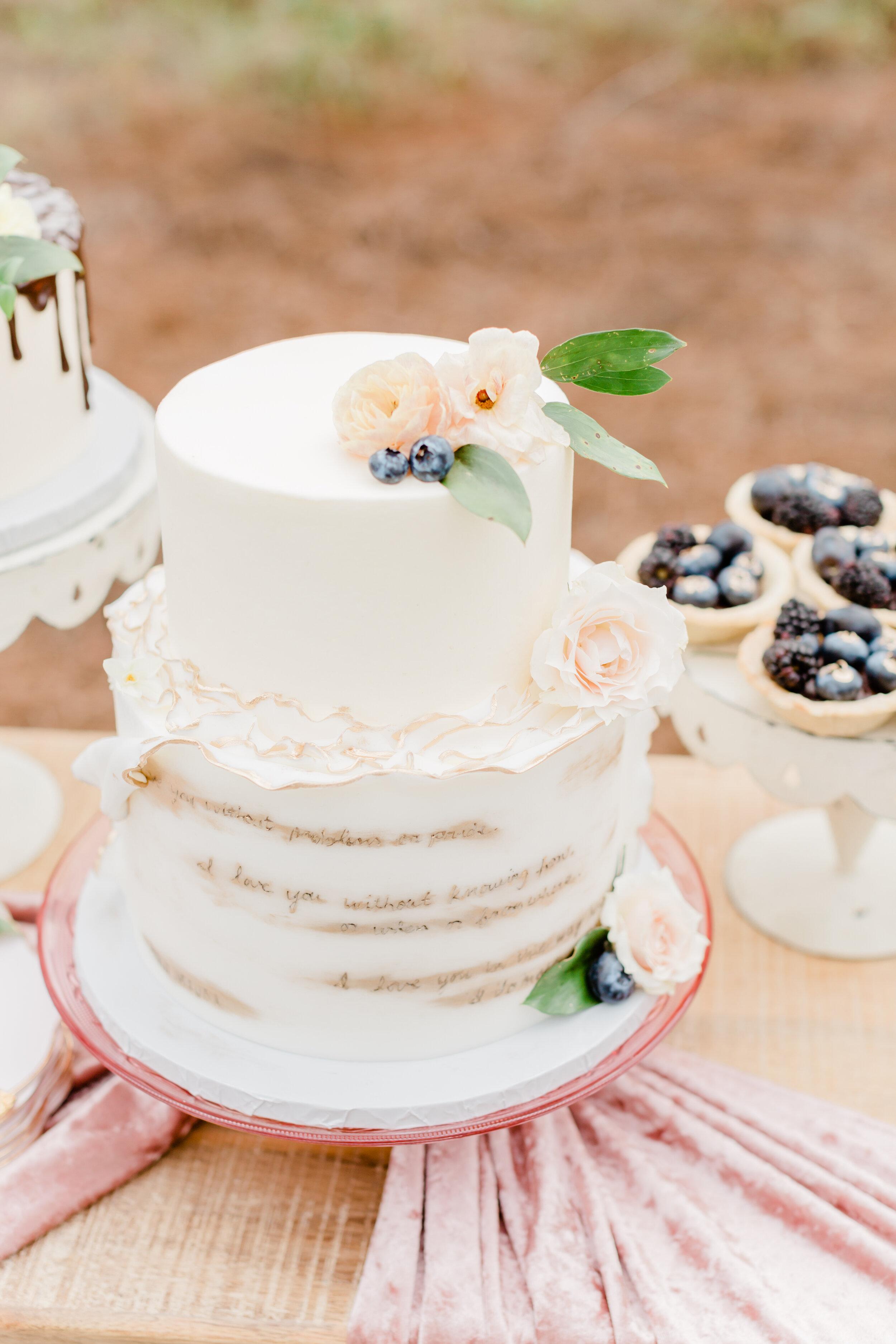 elegant and sophisticated white wedding cake design on pretty pink silk velvet table runners