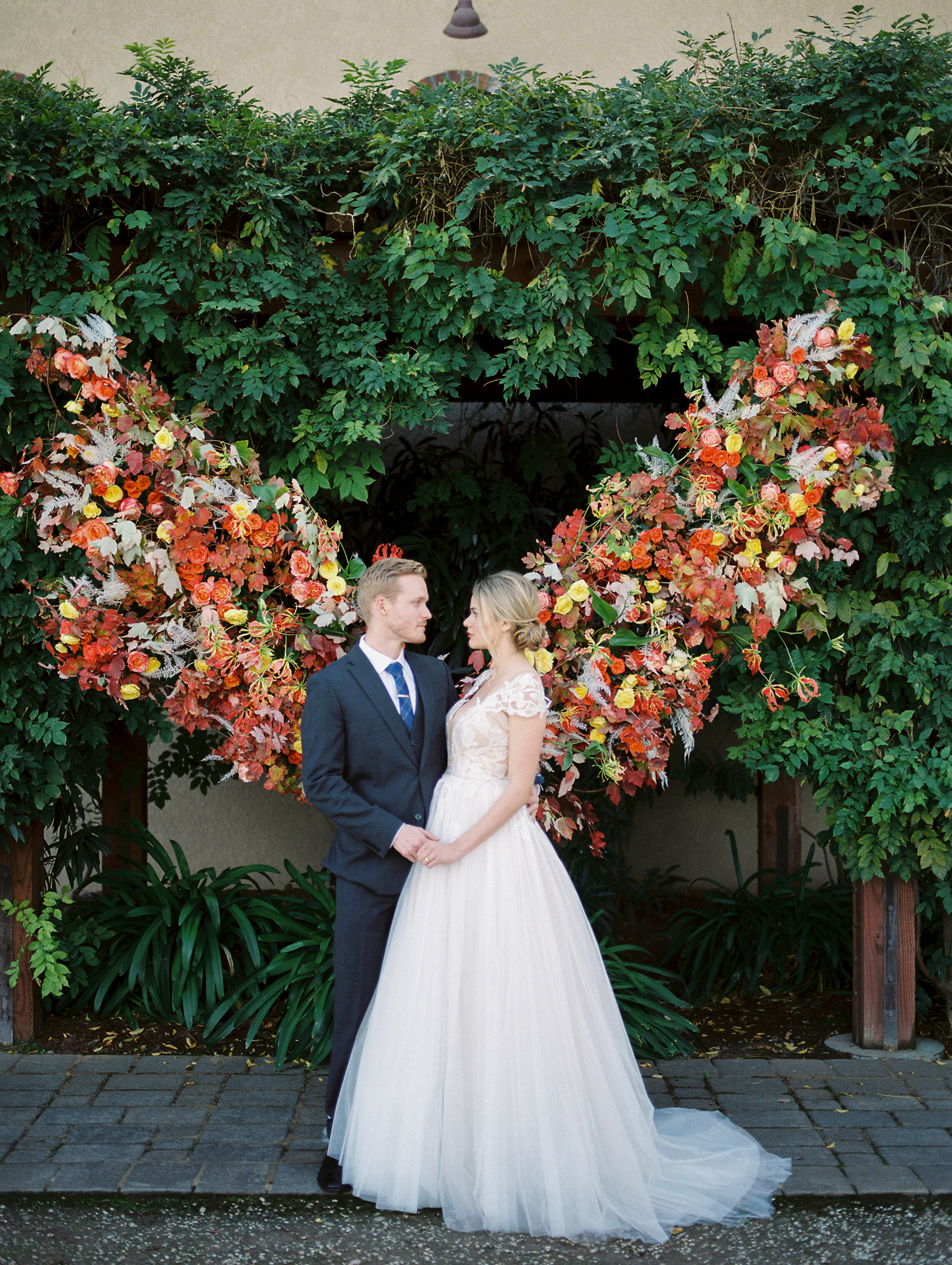 Fall inspired wedding couple photo shoot idea with gorgeous backdrop and bridal gown