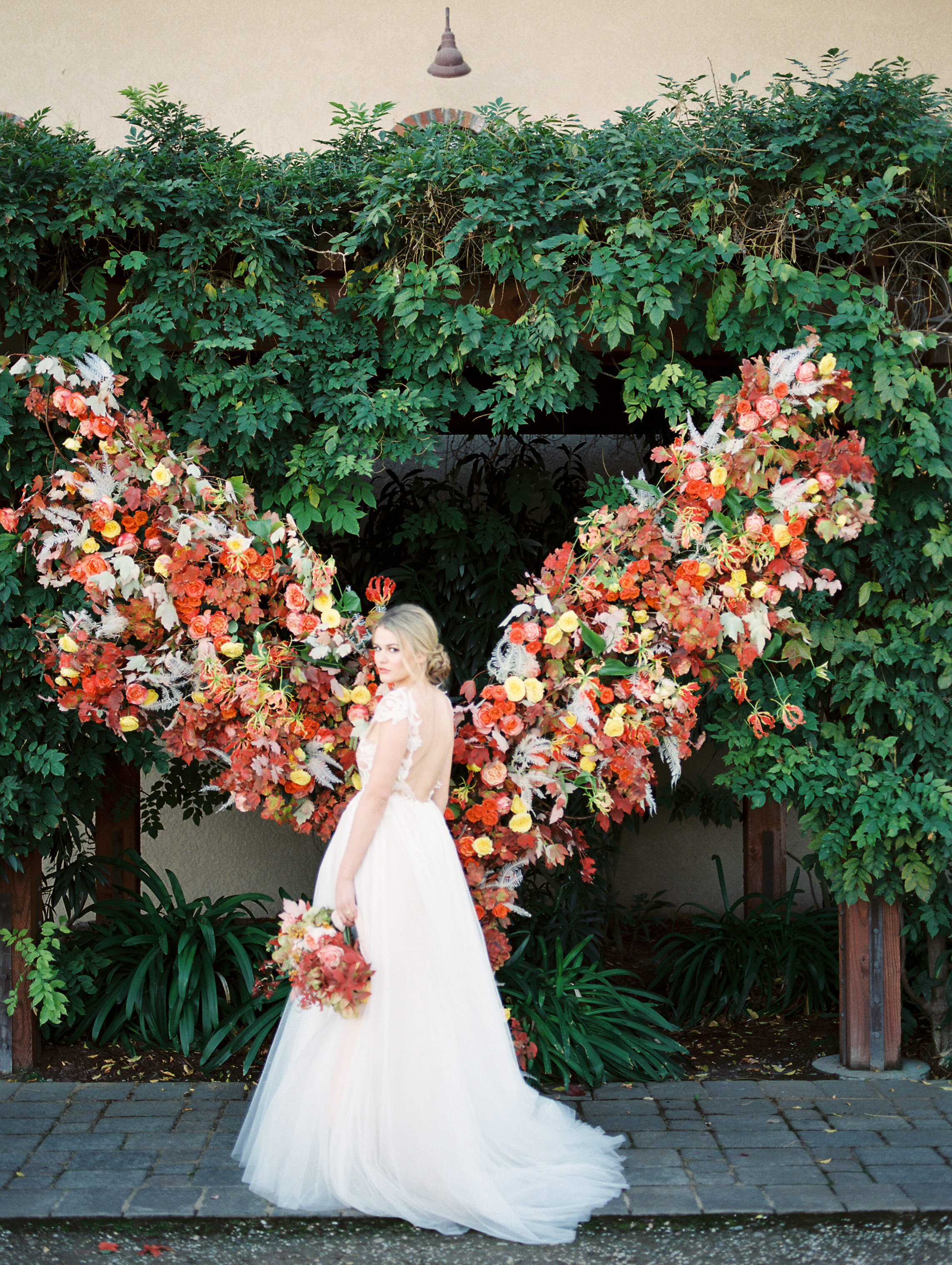 gorgeous wedding gown and bridal updo with pretty fall inspired wedding bouquet with silk ribbons