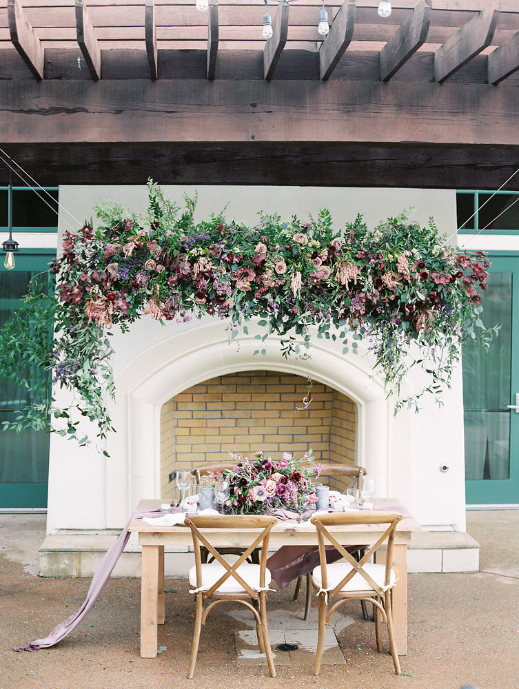 gorgeous lavender themed wedding tablescape and floral hanging installation inspiration