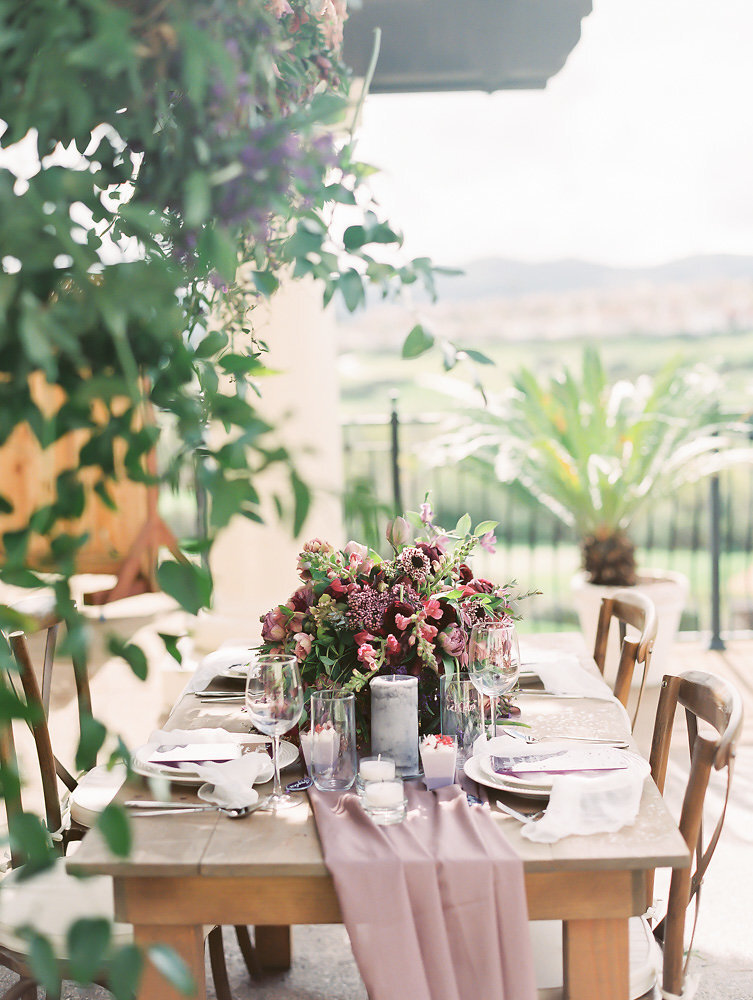 simple and beautiful lavender wedding tablescape with flowy table runners on wooden table inspiration