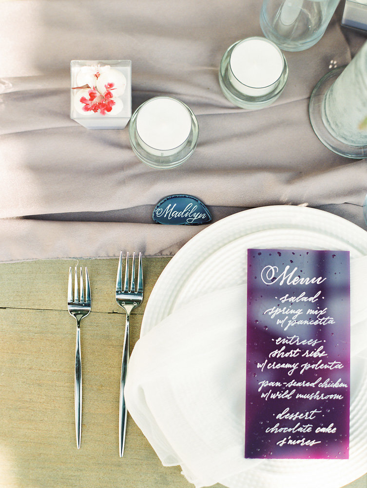 pretty tableware on flowy silk table runners for lavender and purple wedding tablescape inspo