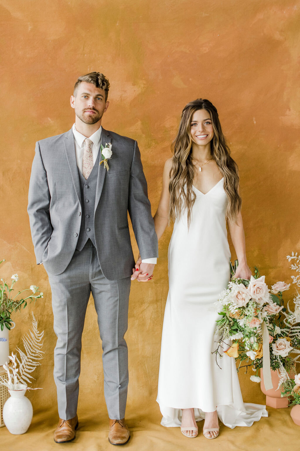 wedding photo shoot goals with gorgeous groom and bridal hairstyle and wedding dress with silk ribbon boho bouquet