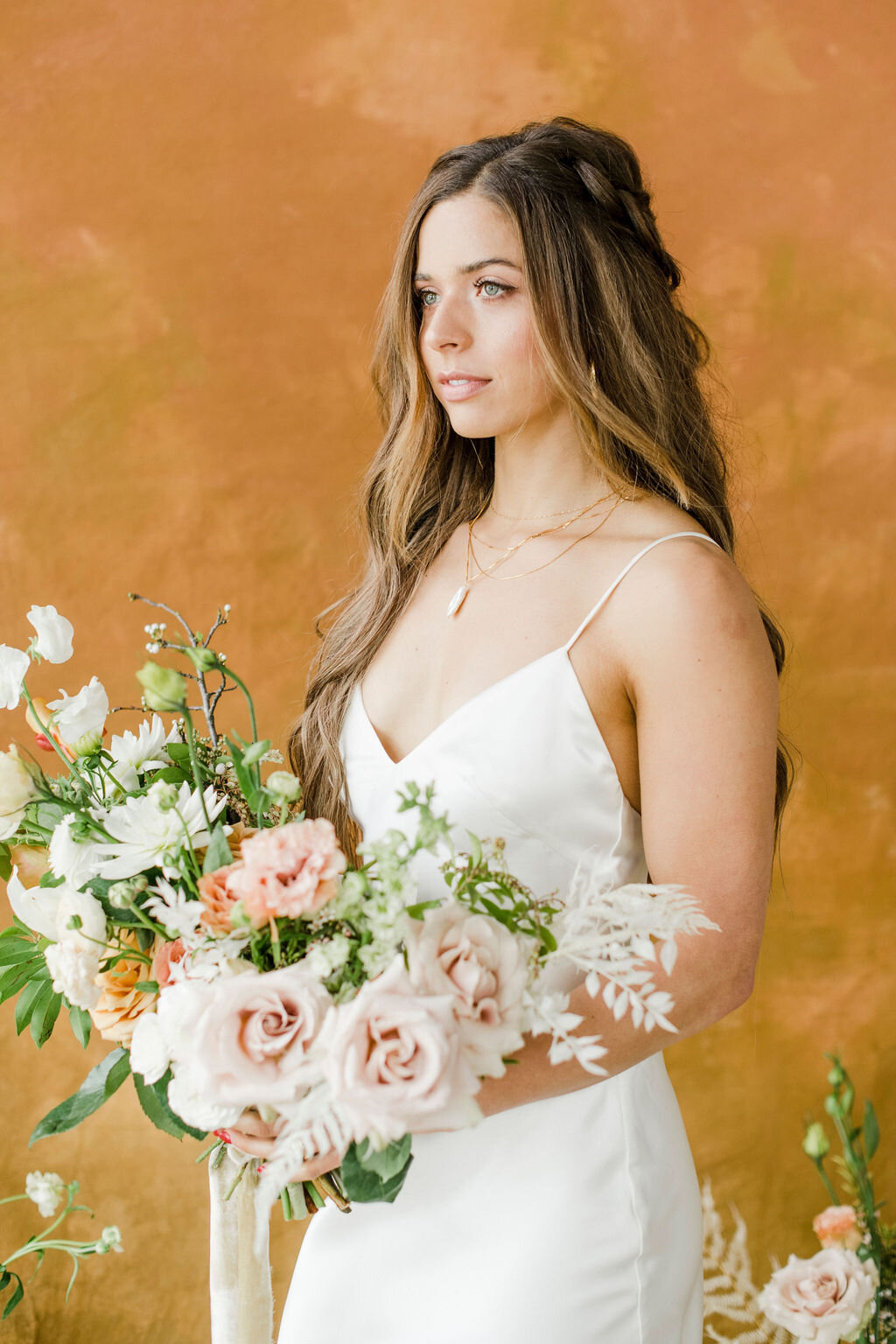 pretty bridal hairstyle and wedding floral bouquet with dreamty silk ribbons for boho fall wedding