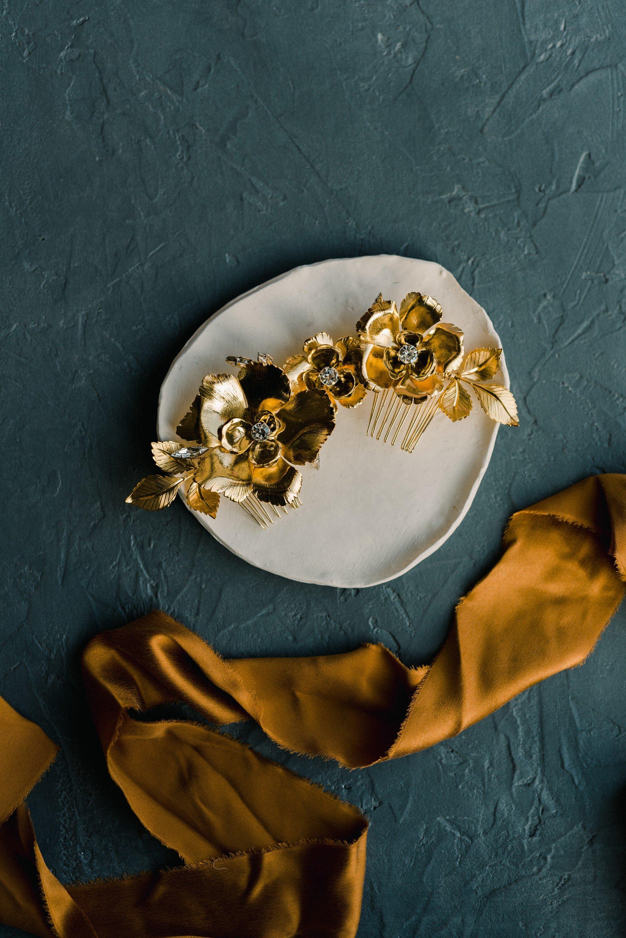 elegant Golden amber velvet ribbons on a mallard blue backdrop for wedding flatlays