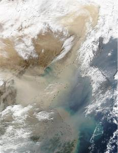 Figure 4. A satellite image of a dust storm over China and Korea. The grey areas show pollution, which may help make the iron in the dust more available to plankton and increase their growth. Image courtesy: NASA.