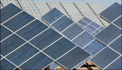 Solar panels, shown here, are used to generate electricity for a small town near Tempe, AZ. Image courtesy of Stock.XCHNG.