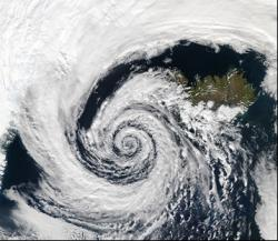 A low-pressure system over Iceland spinning counter-clockwise due to the Coriolis Force. Image courtesy NASA