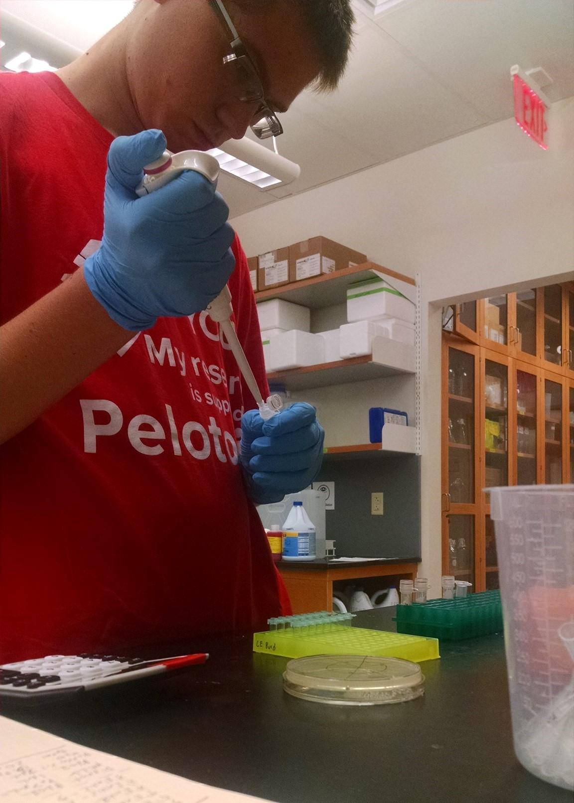Adam working at his Ohio State lab.