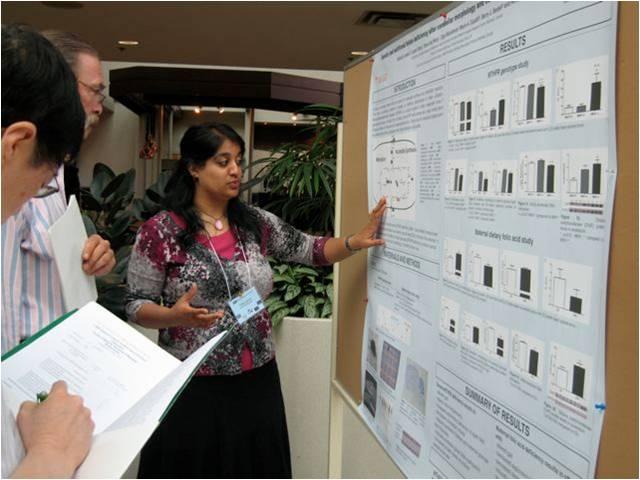 Dr. Jadavji presenting her work at a conference.