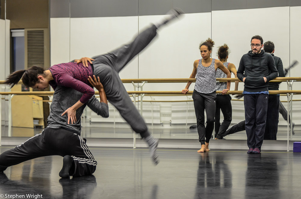 Choreographer Patricia Okenwa with assistant Stefano Rosato watching Liam Francis and Vanessa Kang rehearse a duet.