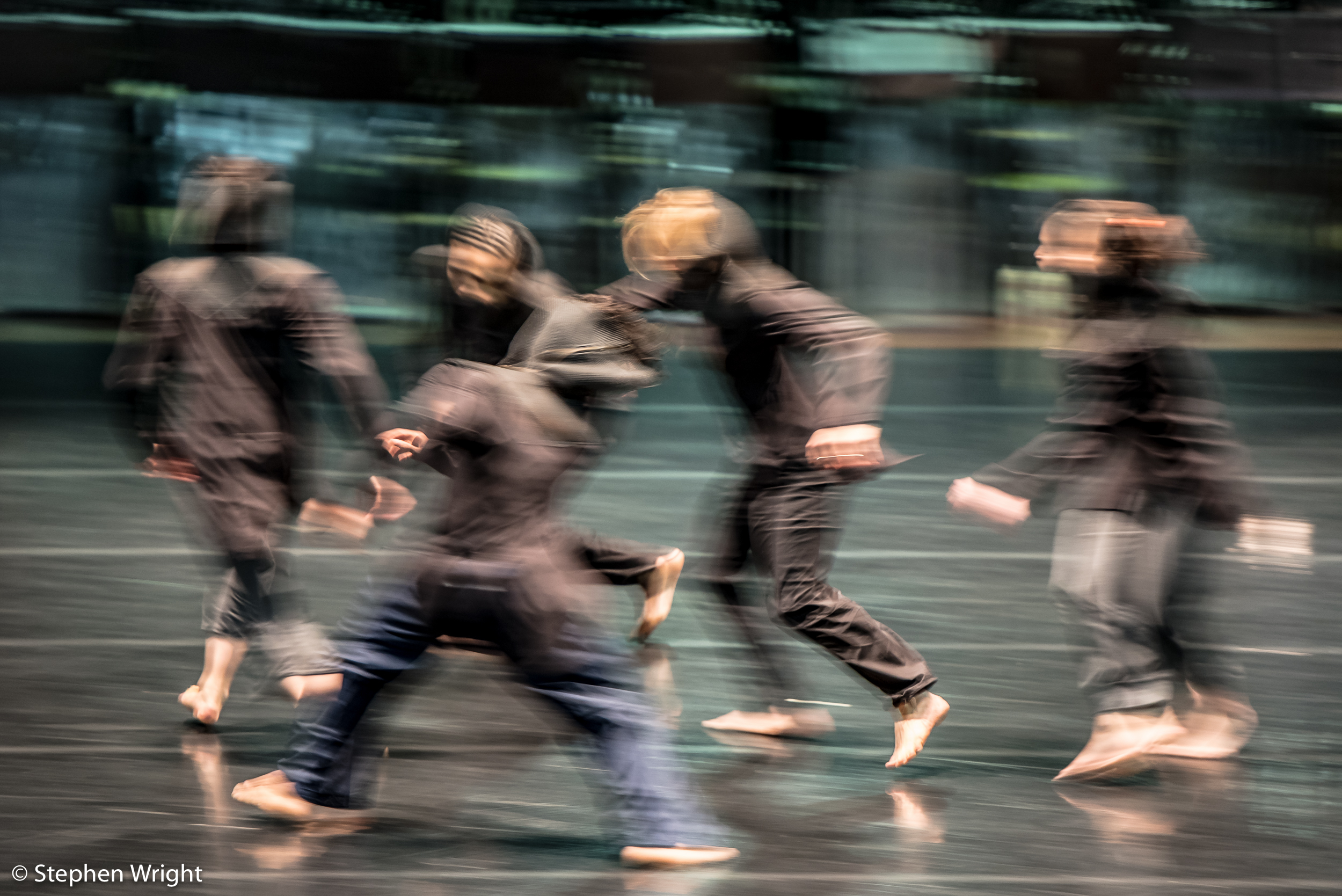 Rambert  dancers on stage rehearsing for   Hydrargyrum  , choreographed by  Patricia Okenwa .