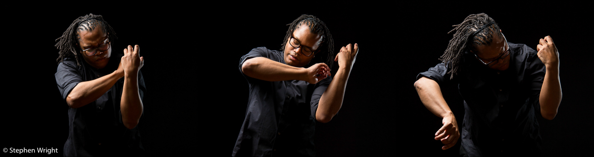 Classical musician  Clifton Harrison  on-set during a movement sequence.