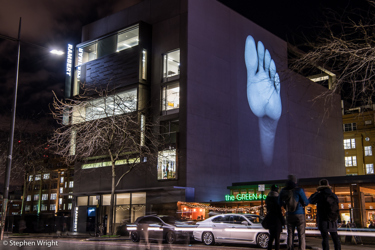 The  Rambert  building as part of the  Lumiere London  festival. Images of the dancer's feet by artist  David Ward .