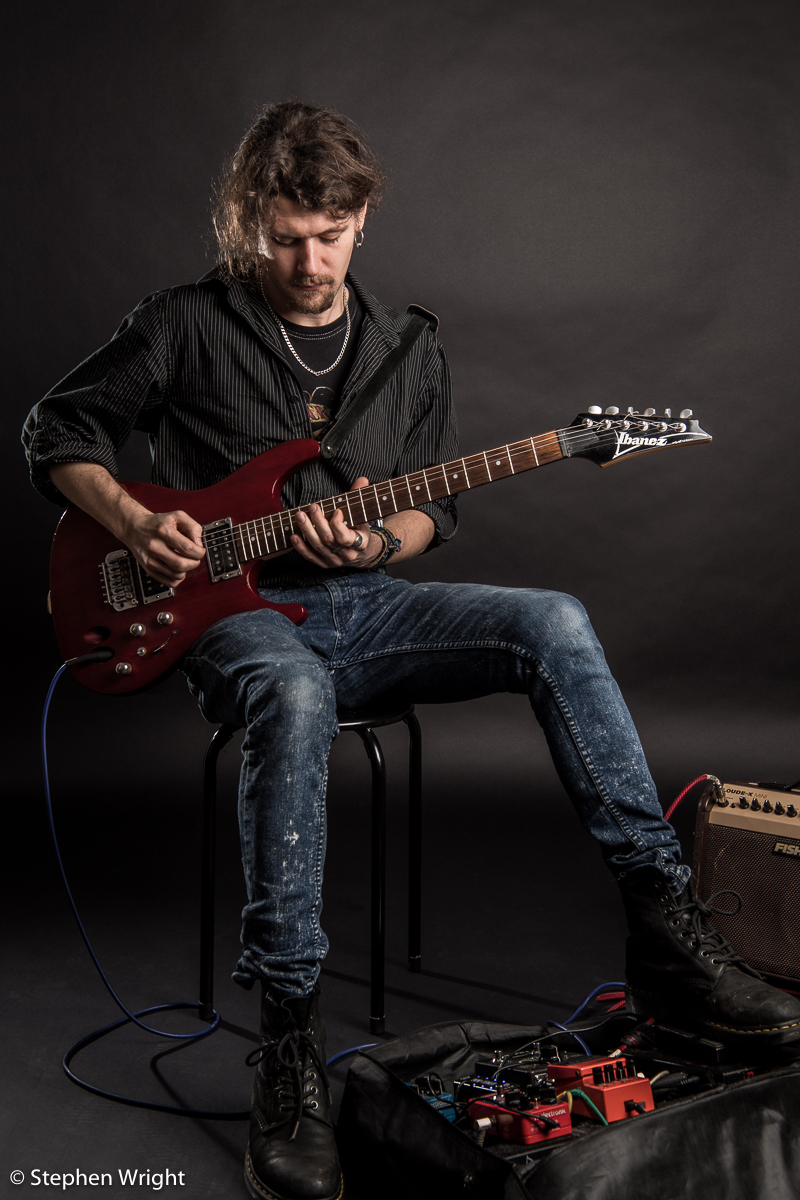 Musician  Alex Paton  on set during his portrait session.