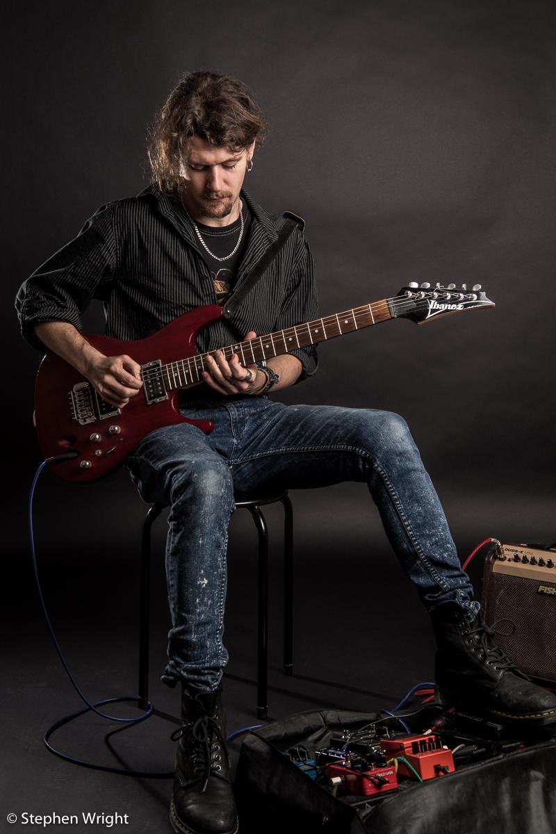 Musician  Alex Paton on set during his portrait session.