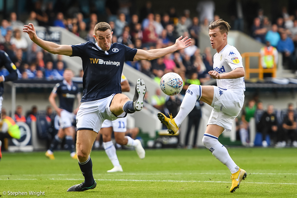 Ezgjan Alioski  of  Leeds  and  Conor McLaughlin  of  Millwall  battle for the ball.