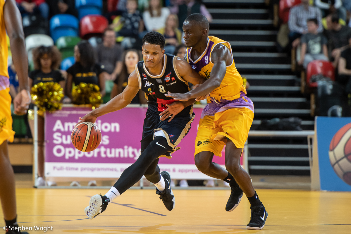 Bouna Ndiaye  of  Glasgow Rocks  takes on  Ladrius Tabb  of  London Lions  in the  British Basketball League  game.