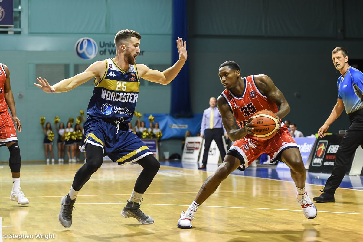 Fred Thomas  of  Bristol Flyers  takes on  Adam Thoseby  of  Worcester Wolves  during the  British Basketball League  game.