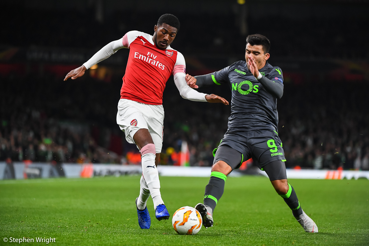 Ainsley Maitland-Niles  of  Arsenal  and  Marcos Acuna  of  Sporting Lisbon  battle for the ball during the  Europa League  group stage match between  Arsenal  and  Sporting Lisbon  at the  Emirates Stadium , London.