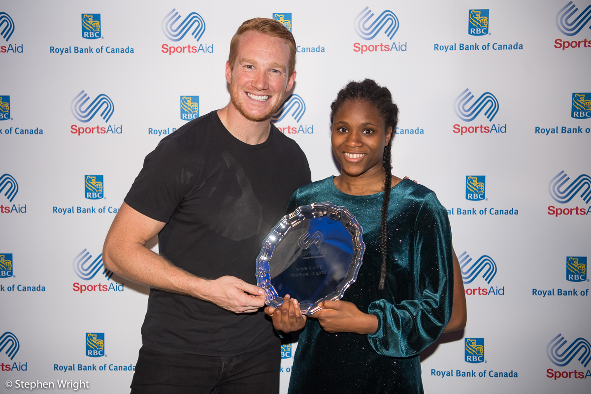Greg Rutherford  hands Boxer  Caroline Dubois  her award as she is named  SportsAid's One to Watch 2018 .