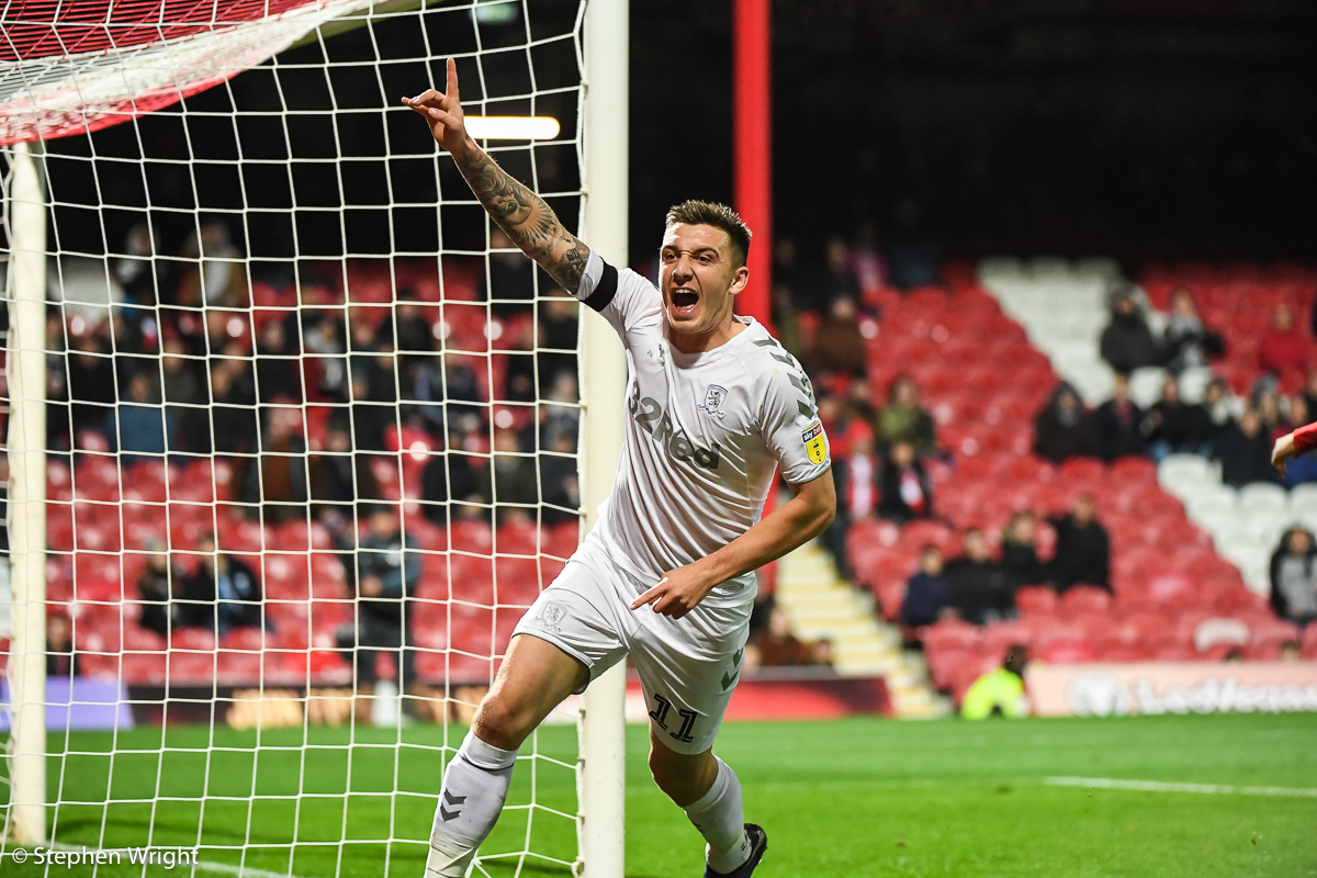 Jordan Hugill  of  Middlesbrough  celebrates scoring a goal during the  EFL Sky Bet Championship  match between  Brentford  and  Middlesbrough  at  Griffin Park .
