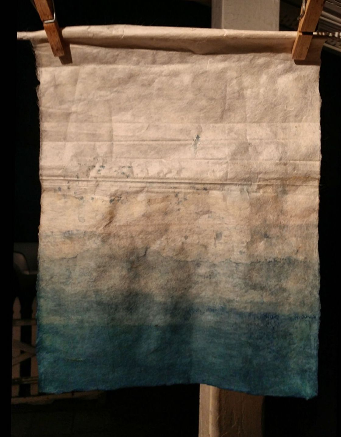 Handmade kozo paper dip-dyed in indigo.