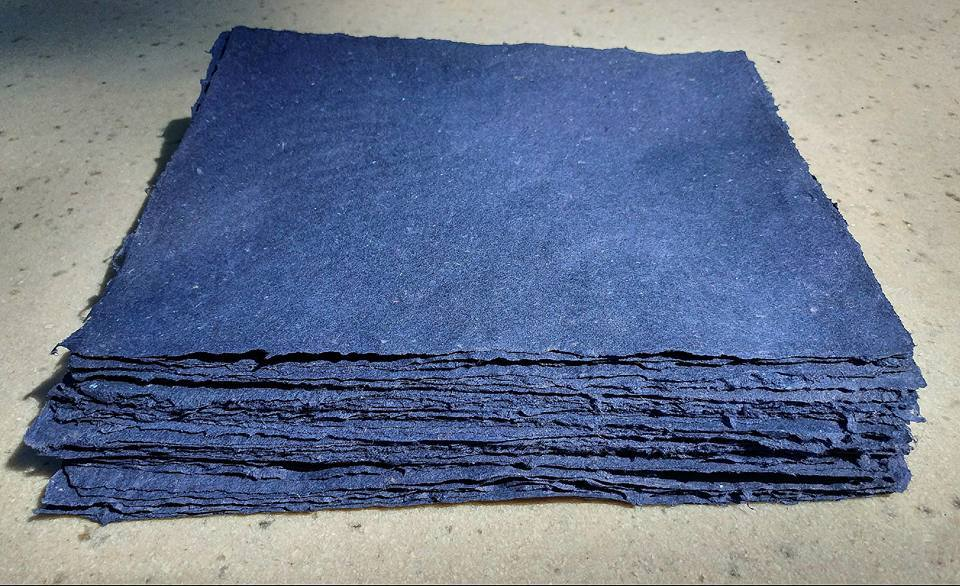 "Sheets of pigmented blue ""garbage"" pulp made from cotton, abaca, gampi, kozo, and flax."