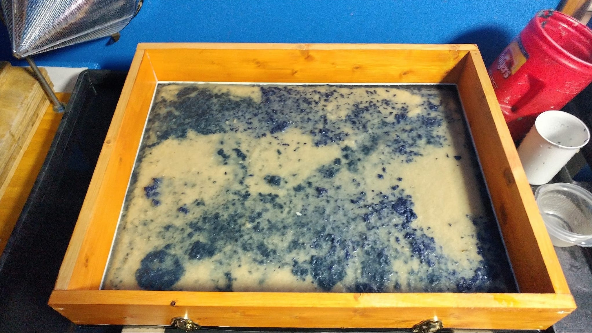 Making paper using bleached iris fibers, pigmented kozo, and the house blend.