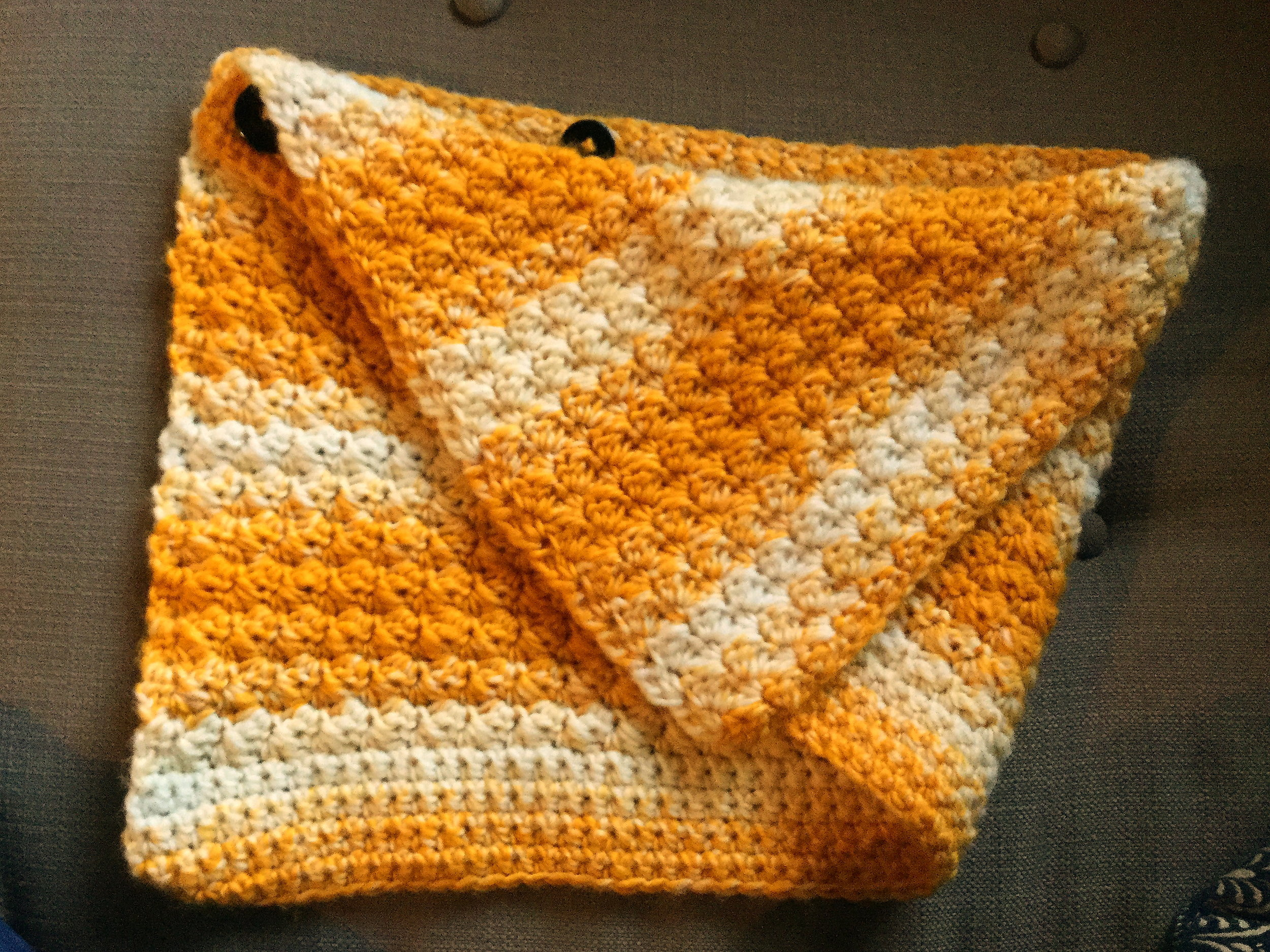 A cheery, cozy button cowl for a friend with a sunny personality