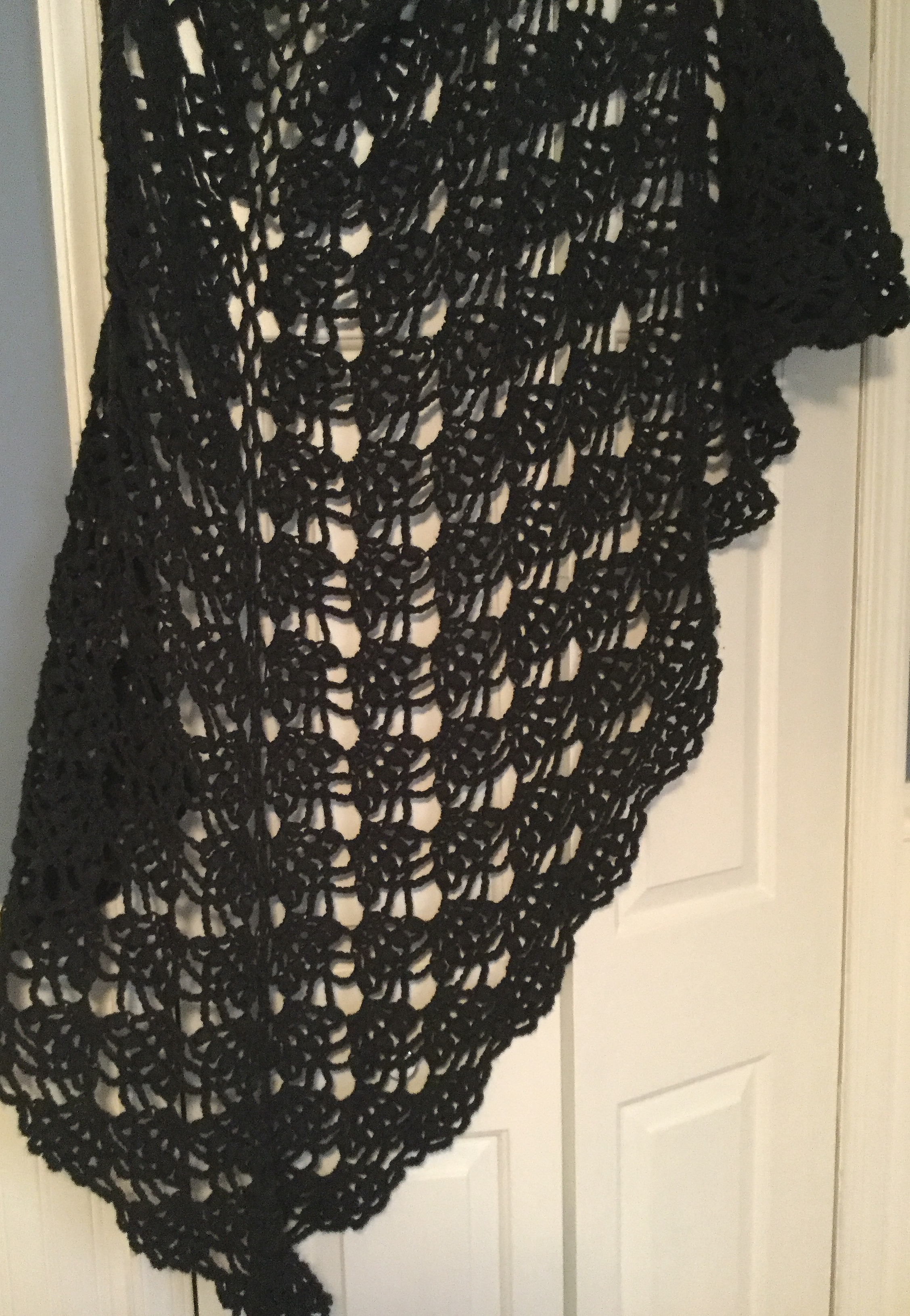 A gi-GAN-tic scallop-shell shawl in charcoal gray - one of my earliest creations - my mother gave me a fantastic brooch I use as a closure