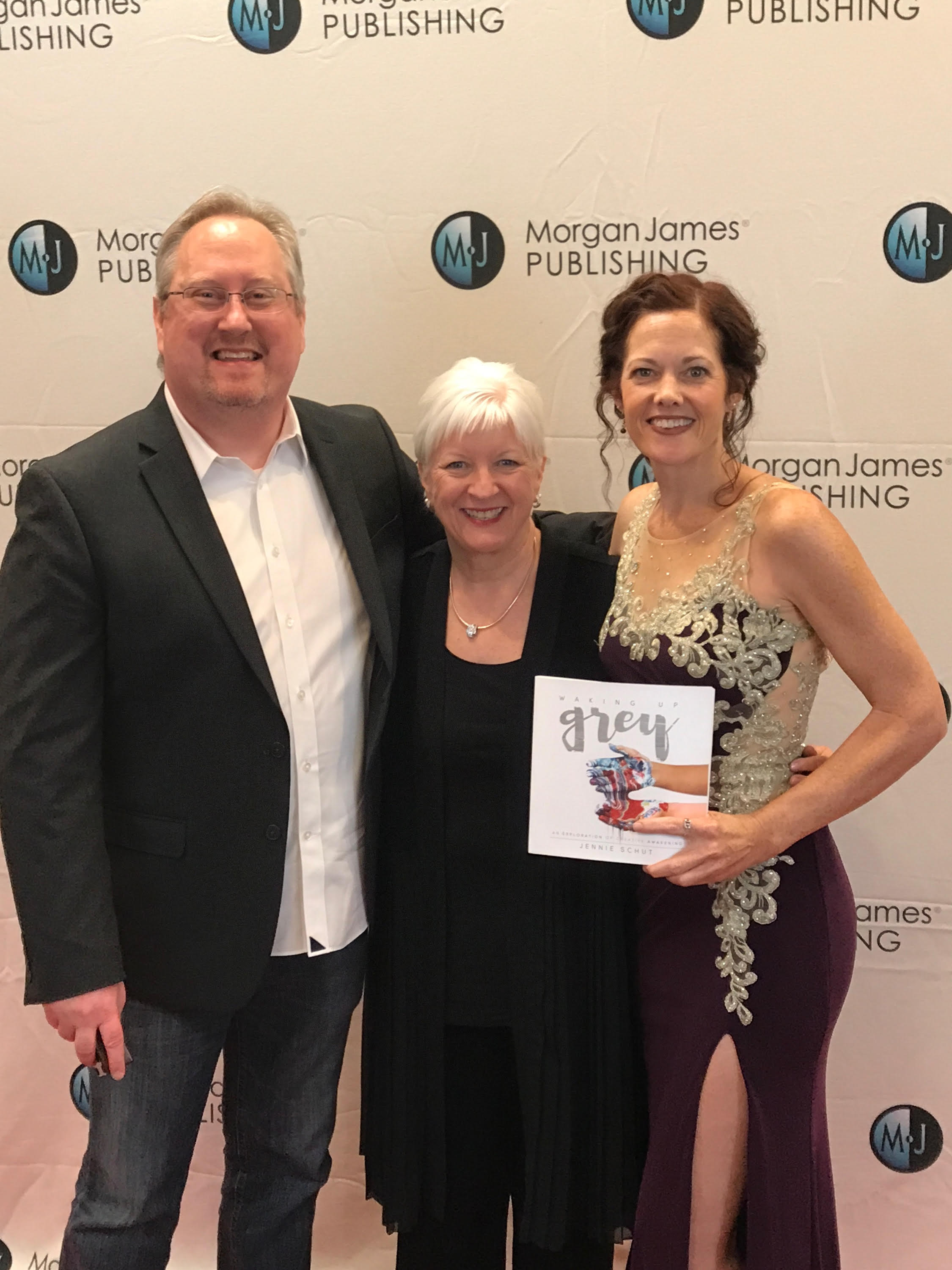 "My publisher, Morgan James Publishing, with offices in New York and Virginia, held a Red Carpet event for the Spring/Summer 2017 authors recently here in Nashville, TN.  And what an event it was.  I had never attended a ""red carpet"" event before and probably never will again.  And as a mom of four and a studio artist, you can usually find me in jeans with holes, an old t-shirt and my painting apron.  This night, I had an opportunity to dress up and look like a girl.  There were close to 20 authors being celebrated that evening and I was grateful to be one of them.  We all had an opportunity to walk the red carpet and talk a few minutes about our books.  You can catch the video  here .  Pictured with me in the photo above is the founder, creator and leader of Morgan James Publishing, David Hancock.  In the middle is Morgan James acquisitions editor and dear friend, Karen Anderson.  Karen went through my material early on, as it was being written and birthed.  She was so formative in the process and important in the way  Waking Up Grey  was created.  And she believed in the process and the project so much that she made sure that it got to the right place so that it could reach as many as possible.  One thing became clear as I met the Morgan James family face to face for the first time over this event.  All that have hands in the publishing process deeply care that the passions and voices of the authors get to the people they need to get to.  They are careful and selective about the content they are putting out into the world.  I learned that MJP gets 5,500 submissions a year and only chooses to release 200 titles a year.  I am deeply grateful to be included in such a selective, hand chosen group of books.  Their belief in me and what I am passionate to say reminds me why I am doing what I do.  It is because of my passion for you, the reader, to find a deep sense of freedom and spaciousness within yourself to do all that is in your heart.  God doesn't just approve, or give us permission to follow our dreams.  He is the one that actually plants our deep desires and longings and everything that is in our lives will either water that plant or wither it.  My prayer is that you are making movements toward more life and light and flourishing.  God wants you to flourish.  He wants goodness and joy and beauty and creativity to have a place to be nourished and to grow within you.  It must begin with you.  You must be nourished first before you can extend it out.  And, like I found over the course of the publishing process, you will begin to find those in your life that believe in your dreams and your work just as much as you do.  Look for those people and reach out and ask for help.  As you begin to make small steps, you will begin to see that the universe is eager to help.  It is abundant and generous, not scarce and rigid.  I hope your voice begins to take up more space and your dreams begin to move from formless and void into particular shapes and textures and colors.  That's my hope for you.  Look in the coming weeks for more from me as your creative midwife.  I'm here as a resource for you!  Let's dream and fly together!"